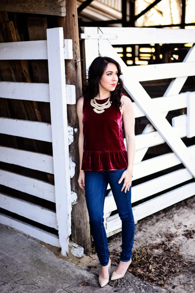 Red Velvet Top With Statement Necklace Moderately High Maintenance