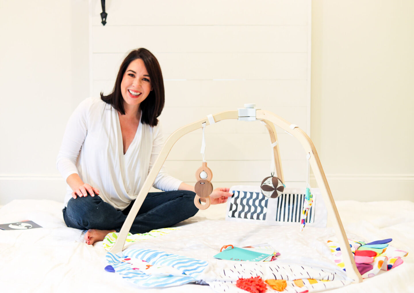 Best Baby Items by popular Atlanta motherhood blog, Moderately High Maintenance: image of a woman sitting next to a Lovevery Play Mat.