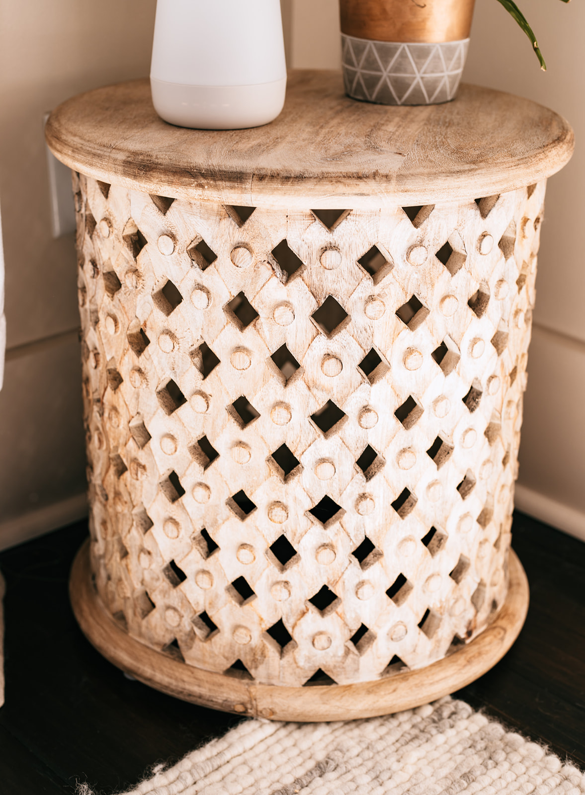Gender Neutral Nursery by popular Atlanta lifestyle blog, Moderately High Maintenance: image of a round wooden table.