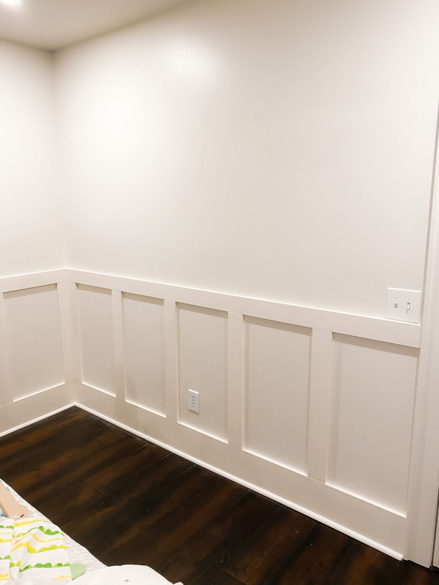 Gender Neutral Nursery by popular Atlanta lifestyle blog, Moderately High Maintenance: image of a empty room with wood floors and board and batten walls.