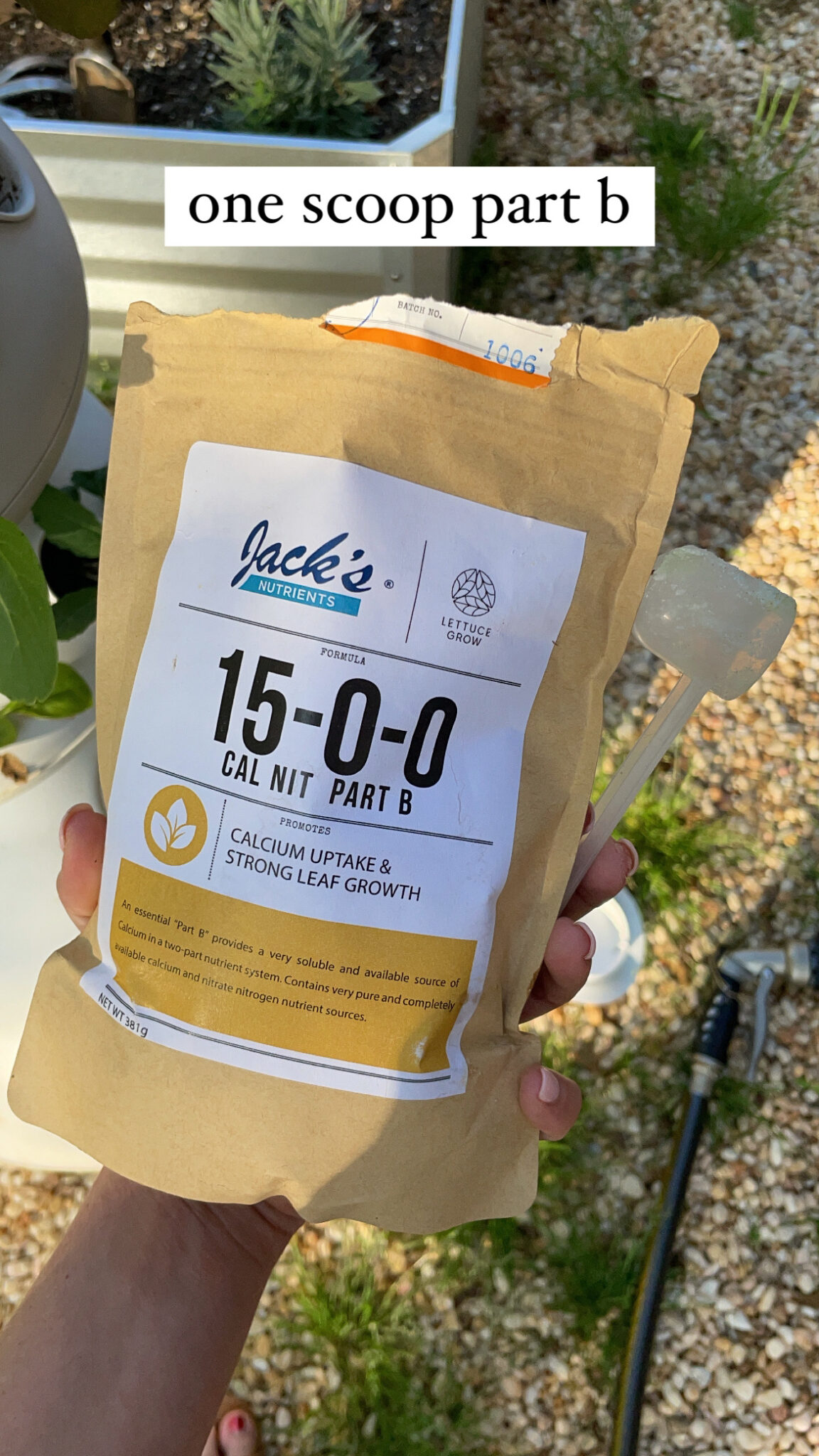 easy hydroponic garden, featured by top Atlanta lifestyle blogger, Moderately High Maintenance | Hydroponic Garden by popular Atlanta lifestyle blog, Moderately High Maintenance: image of a woman holding bag of Jack's Nutrients.