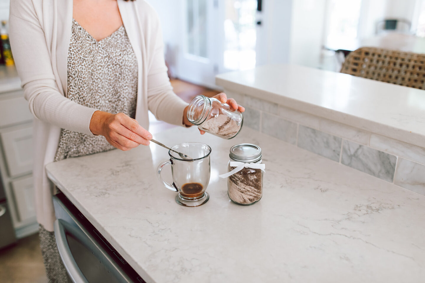 Friendship Tea Recipe perfect for Fall featured by top Atlanta luxury lifestyle blogger, Moderately High Maintenance \  Friendship Tea by popular Atlanta lifestyle blog, Moderately High Maintenance: image of a woman making friendship tea.